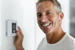 man with thermostat